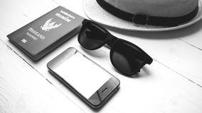 Hat sunglasses smart phone and passport black and white color Stock Photo