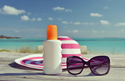 Hat, sunglasses and sun lotion Stock Images