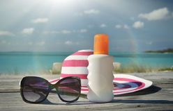 Hat, sunglasses and sun lotion Royalty Free Stock Image
