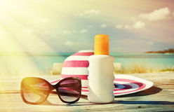 Hat, sunglasses and sun lotion. Stock Image