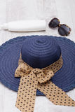 Hat sunglasses sun and protection cream Royalty Free Stock Images