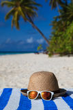 Hat and sunglasses on tropical vacation Stock Image
