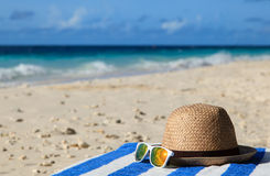 Hat and sunglasses on tropical vacation Royalty Free Stock Images