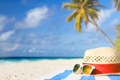 Hat and sunglasses on tropical vacation Royalty Free Stock Photo