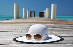 Hat and sunglasses Stock Photos