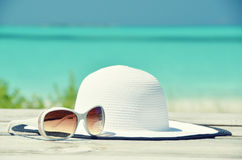 Hat and sunglasses on the wooden jetty Royalty Free Stock Photography