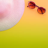 Hat and sunglasses. On yellow background. Summer holiday and travel concept. Copy space background, top view flat lay overhead. Toned royalty free stock image