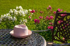 Hat on table, summer vacation. Hat on table in country house, summer vacation Stock Images