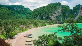 Hat Tom Sai Beach with long tail boats on the beach. Railay travel destination near Ao Nang, Krabi, Thailand