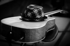 Hat on top guitar. Hat on playing guitar and music Royalty Free Stock Photo