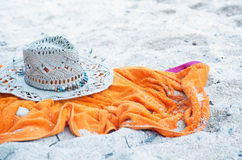 Hat and towel on a beach Royalty Free Stock Image