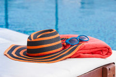 Hat and towel on sunbed royalty free stock image