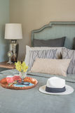 Hat and tray with glass vase flower on bed Royalty Free Stock Image