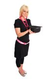 Hat trick. Woman in black with pink beads holding a derby hat Royalty Free Stock Photos