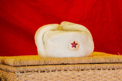 Hat-Ushanka. Fur Russia White Winter Army Badges Snow Snow Clothes USSR Red Star Royalty Free Stock Image