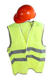 Hat and vest. Construction hard hat and high visibility vest on a white background stock images