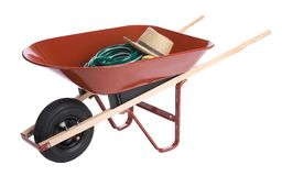Hat in a wheelbarrow Stock Image