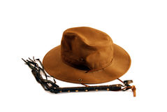 Hat and whip. Dark heavy hat with wide brim and Whip of many tails made of leather and brads Stock Image