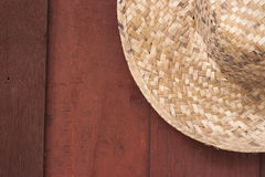 Hat on wood background Stock Photos