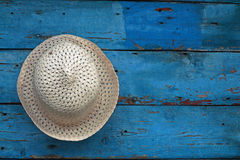 Hat on a wooden background Royalty Free Stock Image