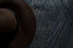 Hat on a wooden surface stock photos