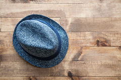 Hat on wooden table Stock Image