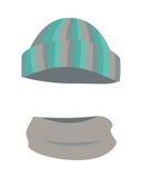 Hat. Woolen Warm Striped Headwear and Grey Scarf. Twisted around. Round hat with green, grey, silver, dark stripes. Warm winter stuff on white background and Stock Photo