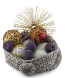 Hat with Xmas balls and star. Wool hat full of assorted Xmas balls and one star Stock Images