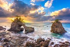 Hatago Iwa rock on the Noto Peninsula in Japan. Noto Peninsula, Ishikawa, Japan at the Hatago Iwa Rock during sunset royalty free stock images