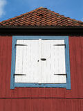 Hatch. A white hatch is situated on the side of a red painted house Royalty Free Stock Photography