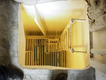 A hatch with a ladder to descend to the next level. Stock Photography