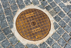 Hatch of sewage on the paving road Stock Photo