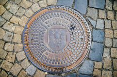 Hatch of sewage on the paving road Stock Images