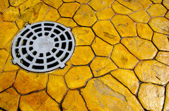 Hatch sewerage. On the road of yellow stone Royalty Free Stock Image
