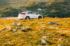 Hatchback Car On In Summer Mountains Landscape In Norway. Drive Stock Photos