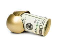 Hatched golden egg with cash. A hatched golden egg reveals some cash for retirement Stock Photography