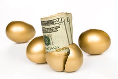 Hatched golden egg with cash. A hatched golden egg reveals some cash for retirement stock photos