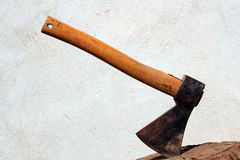 Hatchet. Old ax stuck in a strain of wood stock photography