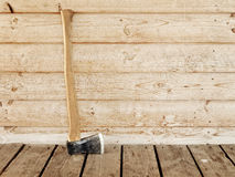 Hatchet. Single old hatchet near the wooden wall Stock Images