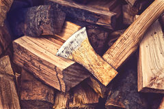 Hatchet Ax and Splitted Wood Logs Royalty Free Stock Photo