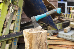 Hatchet Axe. A wood chopping hatchet axe resting in a tree stump used for chopping logs Royalty Free Stock Photography