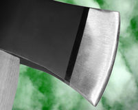 Hatchet / axe head on green Stock Photo