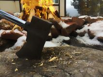 Hatchet by fire royalty free stock image