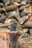 Hatchet and Firewood. Hatchet in stump with firewood Stock Images