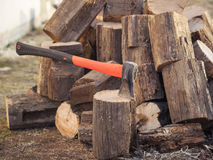 A hatchet for harvesting wood on a background of felled trees. The concept of harvesting wood for rewood Stock Photo