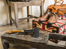 Hatchet and leather shoes. Royalty Free Stock Photography