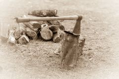 Hatchet Leather Wood Log. Hatchet buried in a piece of leather on a wood block Stock Photos