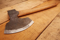 Hatchet on rough-sawn wood Stock Images