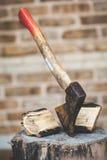 Hatchet sticking in stump beside log lay split Royalty Free Stock Photography