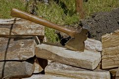 Hatchet stuck in a chunk of wood Stock Photography